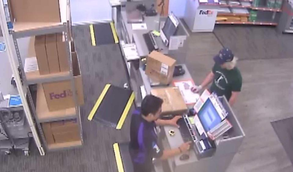 A surveillance image of the bombing suspect in disguise, right, sending a package at a FedEx store / Credit: FBI