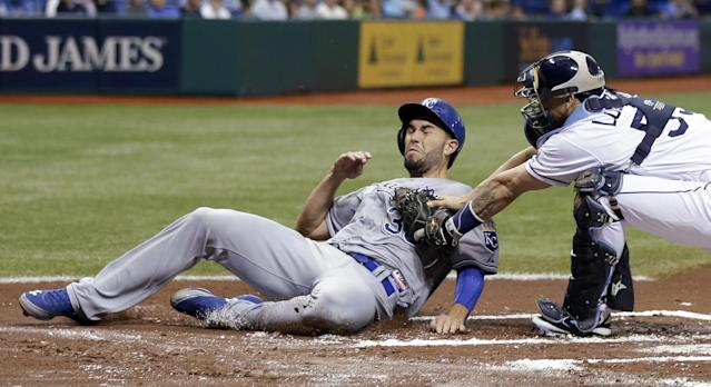 Tampa Bay Rays catcher Jose Lobaton, right, tags out Kansas City Royals' Eric Hosmer at home plate during the first inning of a baseball game, Friday, June 14, 2013, in St. Petersburg, Fla. Hosmer tried to score from third base on a ground ball to Rays' Ben Zobrist. (AP Photo/Chris O'Meara)