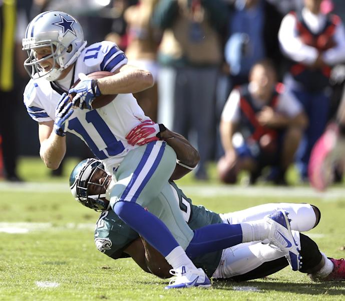 Dallas Cowboys wide receiver Cole Beasley (11) is tackled by Philadelphia Eagles cornerback Brandon Boykin (22) during the first half of an NFL football game, Sunday, Oct. 20, 2013, in Philadelphia. (AP Photo/Matt Rourke)