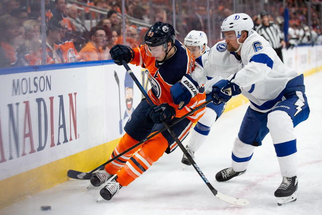 Edmonton Oilers center Ryan Nugent-Hopkins (93) and Tampa Bay Lightning defenseman Anton Stralman (6) vie for the puck during the second period of an NHL hockey game Saturday, Dec. 22, 2018, in Edmonton, Alberta. (Codie McLachlan/The Canadian Press via AP)