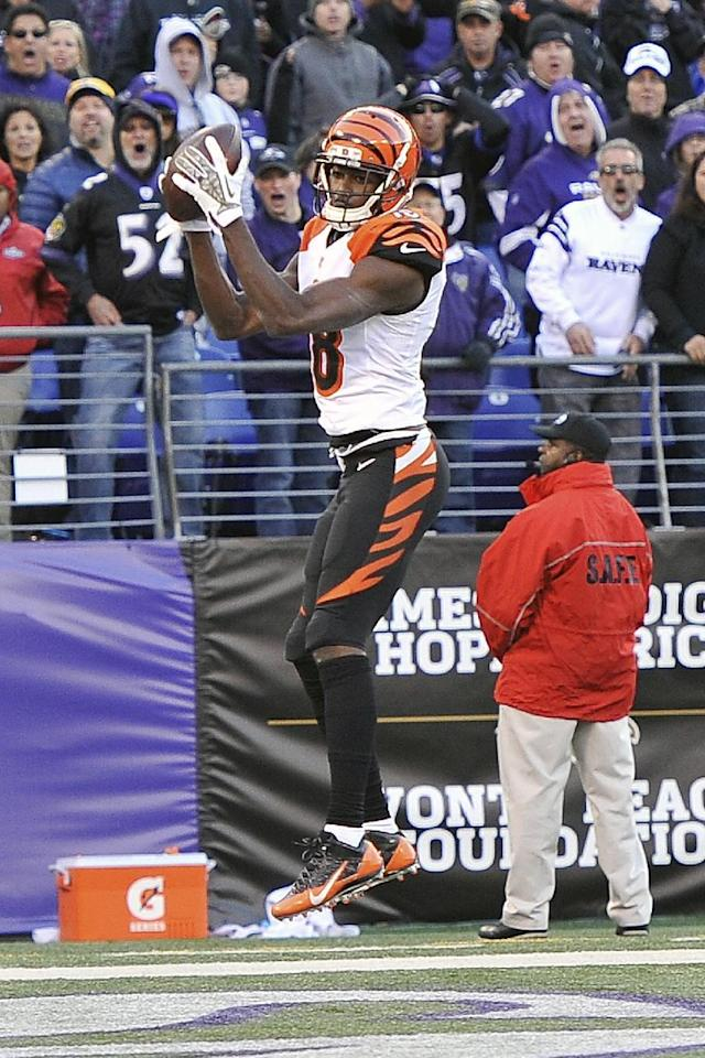 Cincinnati Bengals wide receiver A.J. Green pulls in a bobbled ball for a touchdown during the second half of a NFL football game against the in Baltimore, Sunday, Nov. 10, 2013. (AP Photo/Gail Burton)