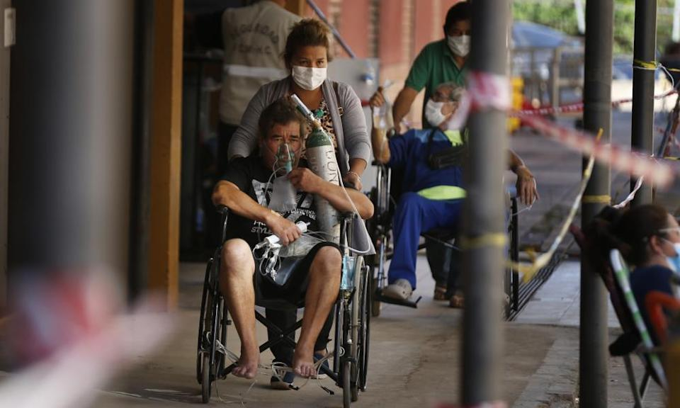 Coronavirus patients are taken to the lab for a test at the Clinicas hospital in San Lorenzo, Paraguay.