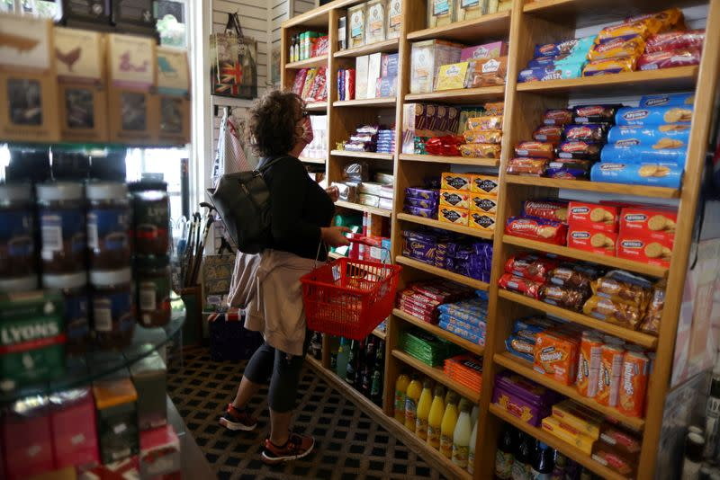 FILE PHOTO: Paula Jarvis, 61, buys biscuits at the King's Head pub as Los Angeles County moves into the least restrictive yellow coronavirus disease (COVID-19) disease reopening tier, in Santa Monica