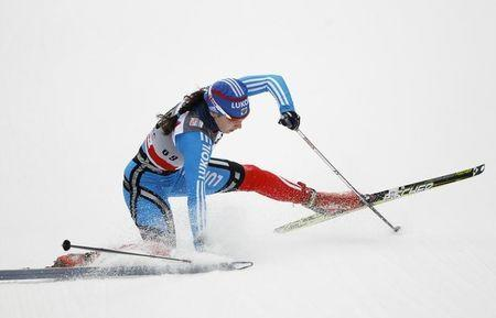 Anastasia Dotsenko of Russia crashes as she competes in the FIS World Cup cross-country skiing 3.1km free individual race in Oberhof, December 29, 2011. REUTERS/Thomas Peter