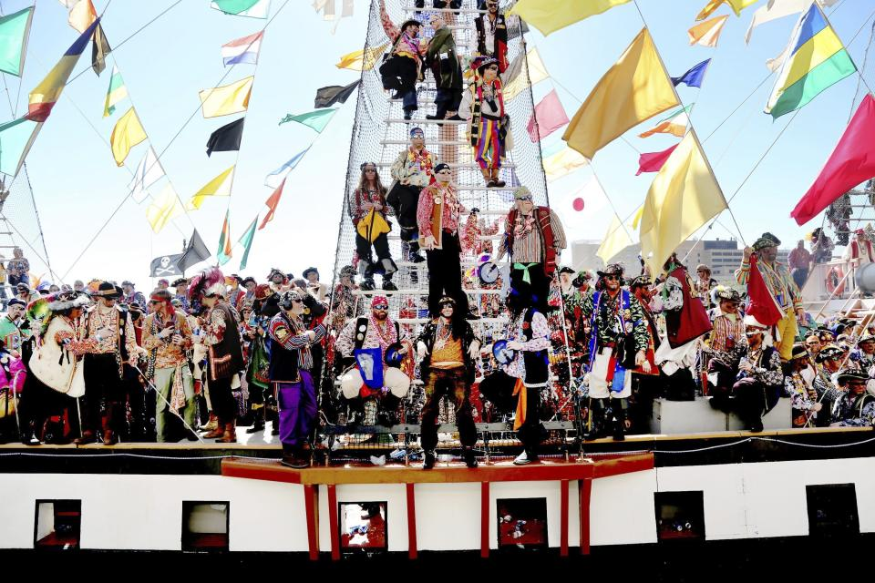 The Jose Gasparilla pirate ship, carrying members of Ye Mystic Krewe of Gasparilla, arrives at the Tampa Convention Center during the 103nd Gasparilla Invasion and Parade of the Pirates on Saturday, Jan. 25, 2020, in Tampa. This year's event was postponed and then canceled due to the coronavirus pandemic. The group now says the next one won't be held until January 2022. (Douglas R. Clifford/Tampa Bay Times via AP)