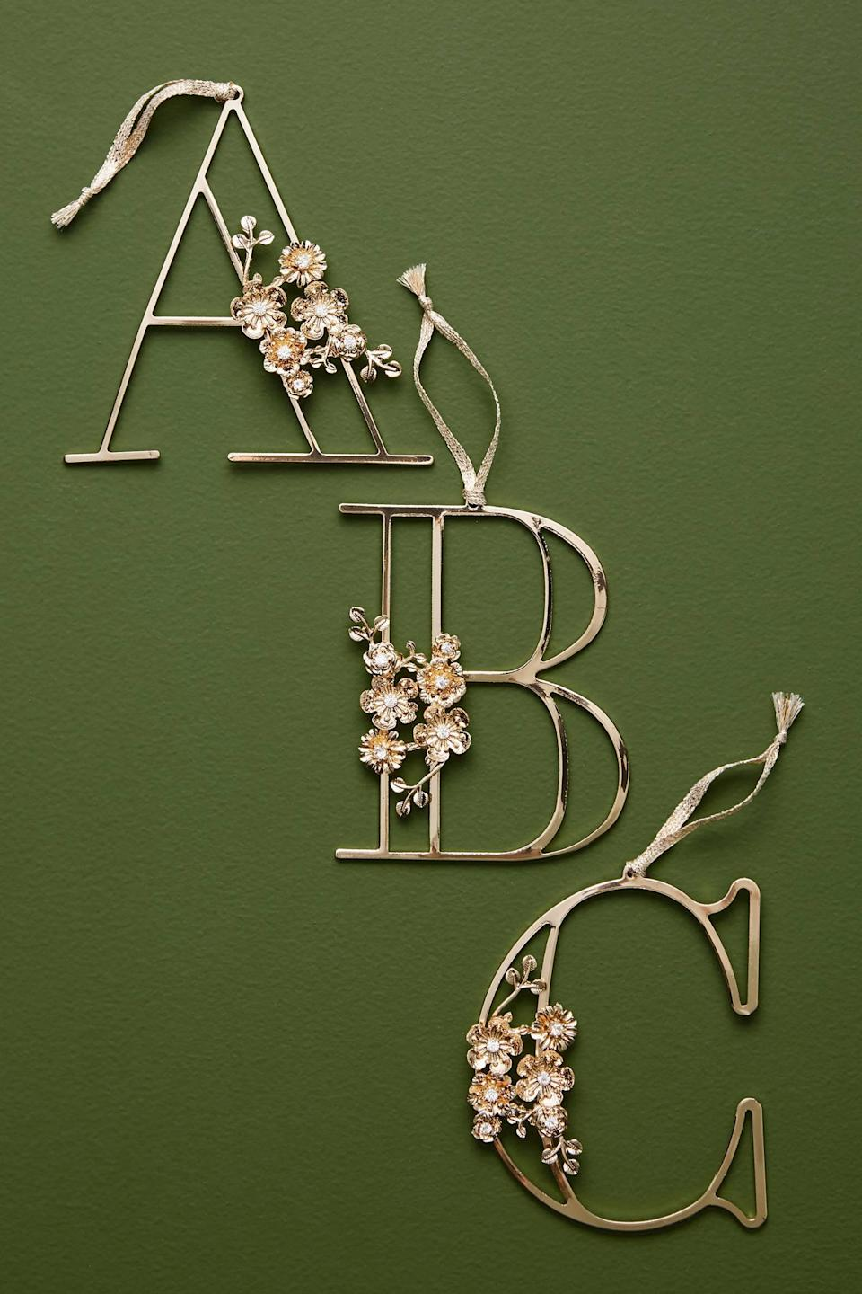 """<p>Add a sophisticated touch to your family tree with the <a href=""""https://www.popsugar.com/buy/Floral-Monogram-Ornament-490441?p_name=Floral%20Monogram%20Ornament&retailer=anthropologie.com&pid=490441&price=12&evar1=casa%3Aus&evar9=46615300&evar98=https%3A%2F%2Fwww.popsugar.com%2Fhome%2Fphoto-gallery%2F46615300%2Fimage%2F46615311%2FFloral-Monogram-Ornament&list1=shopping%2Canthropologie%2Choliday%2Cchristmas%2Cchristmas%20decorations%2Choliday%20decor%2Chome%20shopping&prop13=mobile&pdata=1"""" rel=""""nofollow noopener"""" class=""""link rapid-noclick-resp"""" target=""""_blank"""" data-ylk=""""slk:Floral Monogram Ornament"""">Floral Monogram Ornament</a> ($12).</p>"""