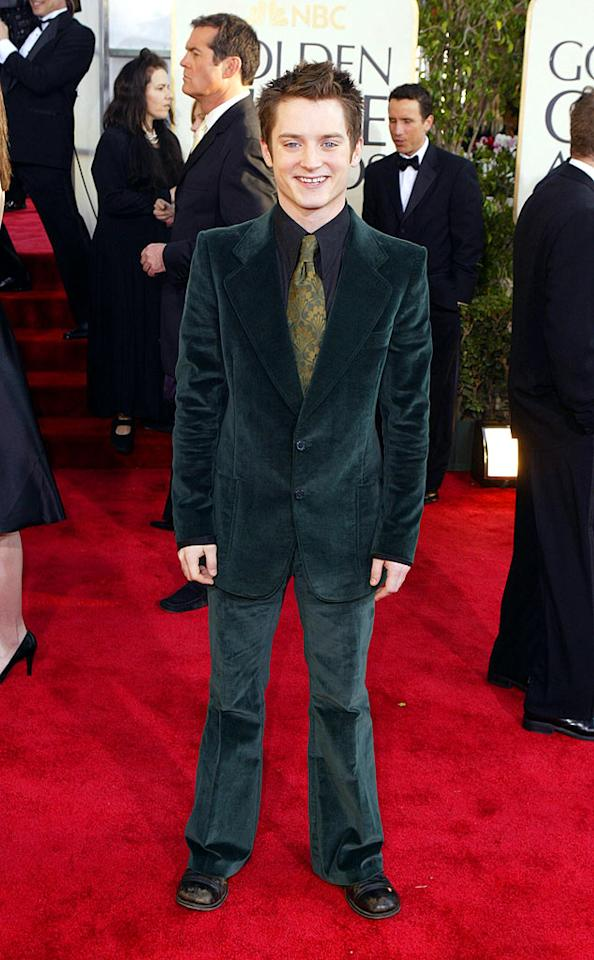 "Elijah Wood looked like a little leprechaun in his velvet green suit from 2004. Jeff Vespa/<a href=""http://www.wireimage.com"" target=""new"">WireImage.com</a> - January 25, 2004"