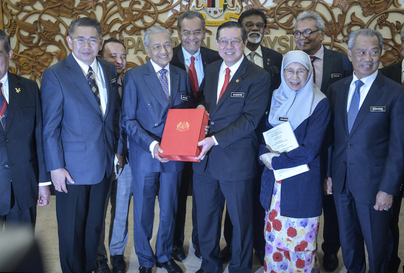 Prime Minister Tun Dr Mahathir Mohamad receives a copy of Budget 2020 from Finance Minister Lim Guan Eng in Parliament October 11, 2019. — Picture by Shafwan Zaidon