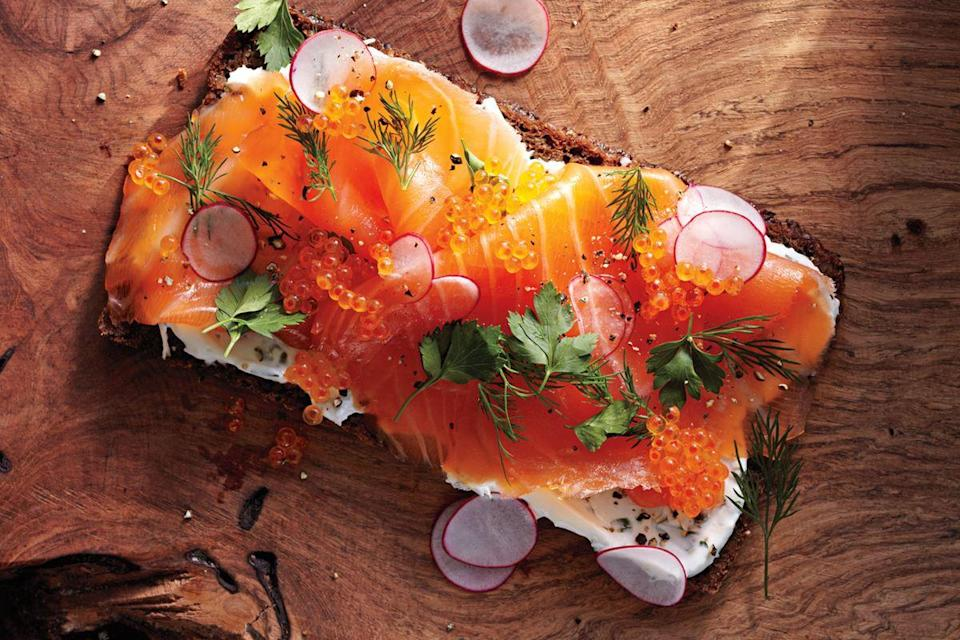"Slather an herb-loaded sour cream spread over dense rye bread and top with smoked salmon and shaved radishes for a stunning appetizer or light lunch. <a href=""https://www.epicurious.com/recipes/food/views/smoked-salmon-smorrebrod-51155280?mbid=synd_yahoo_rss"" rel=""nofollow noopener"" target=""_blank"" data-ylk=""slk:See recipe."" class=""link rapid-noclick-resp"">See recipe.</a>"