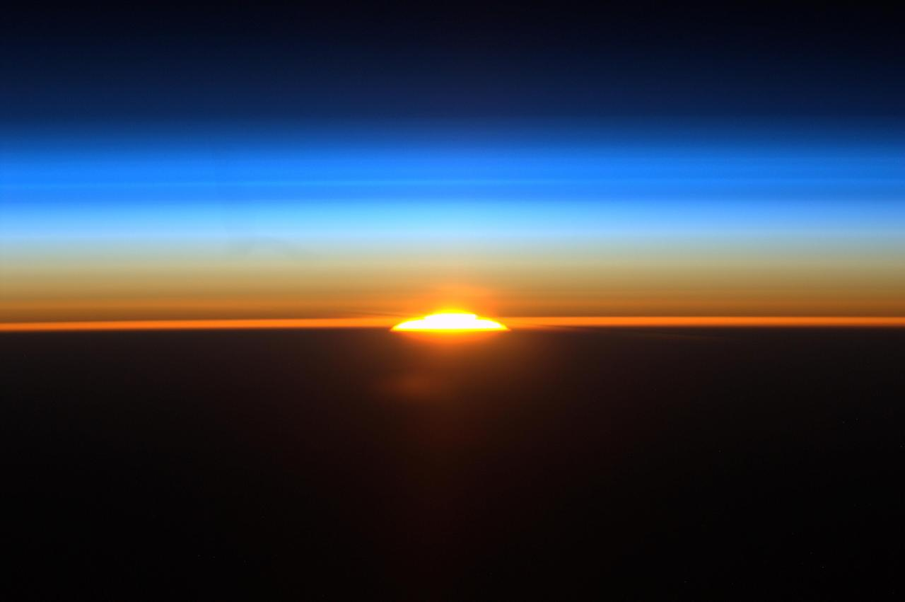 In this Sat., Aug. 27, 2011 photo provided by NASA and taken from aboard the international space station by astronaut Ron Garan, the sun rises above above the earth in one of the sixteen sunrises astronauts see each day. This sunrise image shows the rising sun as the space station flew along a path between Rio de Janeiro, Brazil and Buenos Aires, Argentina. (AP Photo/NASA)