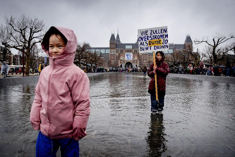 'We will be flooded if [Dutch Prime Minister Mark] Rutte keeps on dreaming' said one placard at the Amsterdam demonstration (AFP Photo/Robin van Lonkhuijsen)