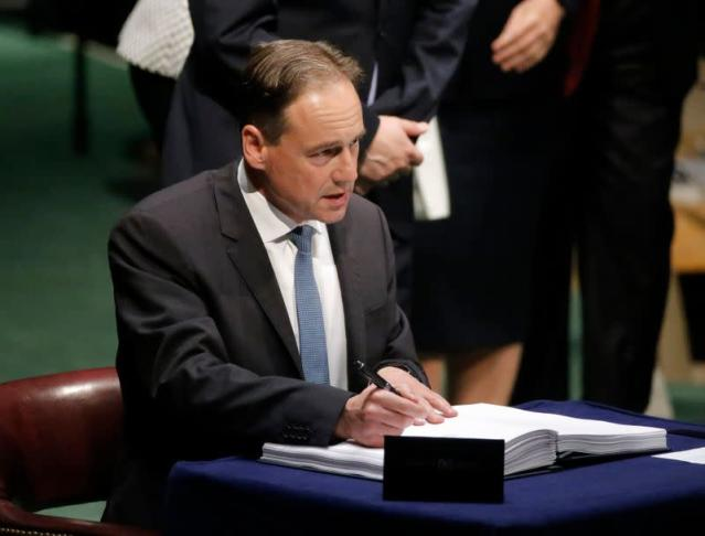 Australian Minister of Environment Greg Hunt signs the Paris Agreement on climate change held at the United Nations Headquarters in New York
