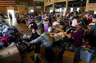 Thousands of food and clothing items are organized by Occupy Sandy volunteers in the school gymnasium at the St. Camillus Roman Catholic Church in the Rockaway Park neighborhood of the borough of Queens, New York, Sunday, Nov.11, 2012, almost two weeks in the wake of Superstorm Sandy. (AP Photo/Craig Ruttle)