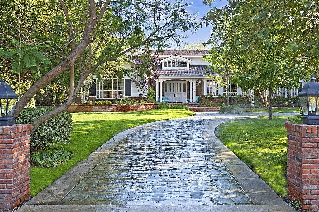 <p>This is the house exterior as it looked in 2008, when Richards first tried to sell it after about a year of ownership. She bought it in 2007 for $4.4 million; tried to sell it at a loss from 2008 to 2010, asking $3.3 million at its lowest point; then decided to keep and expand it. </p>
