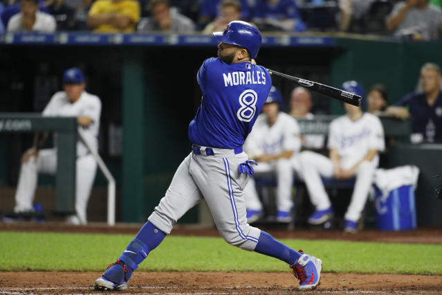 Toronto Blue Jays' Kendrys Morales follows through on an RBI single in the fourth inning of a baseball game against the Kansas City Royals at Kauffman Stadium in Kansas City, Mo., Thursday, Aug. 16, 2018. (AP Photo/Colin E. Braley)