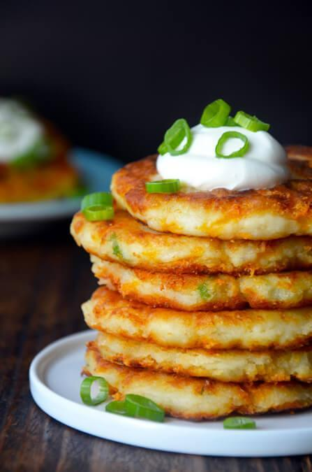"<p>Got a surplus of spuds in your fridge? Not for long with this cheesy mashed potato pancake recipe. Top the satisfying stack with tangy sour cream for an extra indulgent treat.<br>Get the recipe <a href=""http://www.justataste.com/cheesy-leftover-mashed-potato-pancakes-recipe/"" rel=""nofollow noopener"" target=""_blank"" data-ylk=""slk:here"" class=""link rapid-noclick-resp""><strong>here</strong></a><br>[Photo: Just a Taste] </p>"