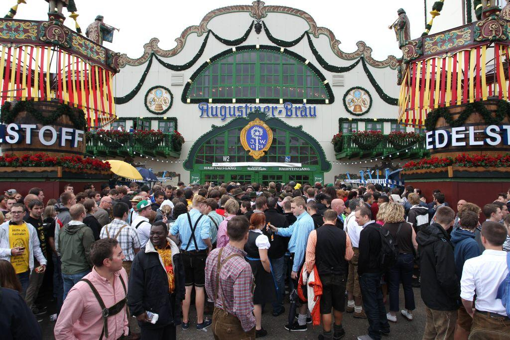 Visitors wait in front of a beer tent during the opening day of Oktoberfest 2012.