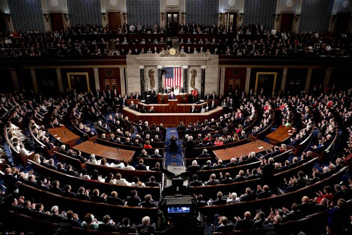 Members of Congress listen as President Trump delivers his State of the Union address on Tuesday. (Yasin Ozturk/Anadolu Agency via Getty Images)