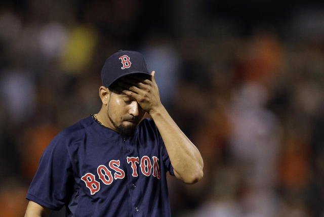 Boston Red Sox relief pitcher Franklin Morales wipes sweat from his brow after Baltimore Orioles' Steve Pearce drove in two runs on a double in the eighth inning of a baseball game, Saturday, Sept. 28, 2013, in Baltimore. Baltimore won 6-5. (AP Photo/Patrick Semansky)