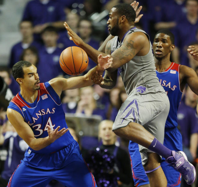 Kansas forward Perry Ellis (34) strips the ball from Kansas State forward Thomas Gipson during the first half of an NCAA college basketball game in Manhattan, Kan., Monday, Feb. 10, 2014. (AP Photo/Orlin Wagner)