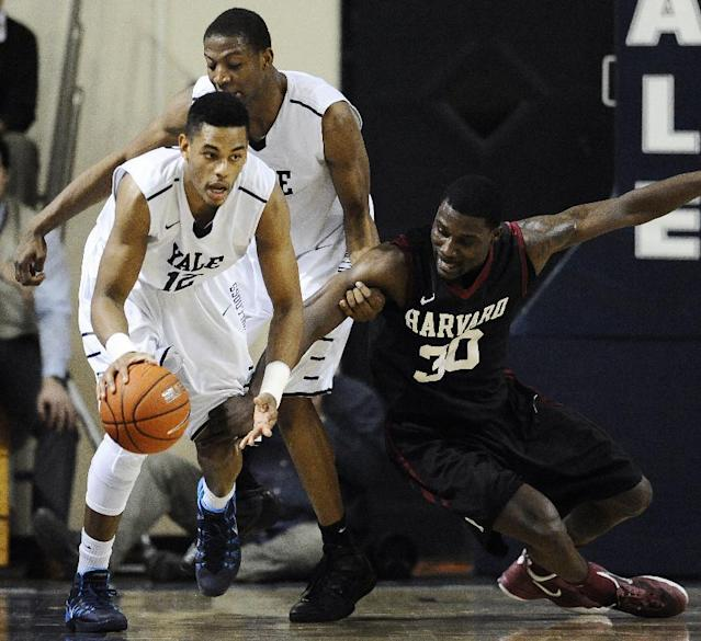 Yale's Armani Cotton, left, grabs control of the ball over Harvard's Kyle Casey, right, as Yale's Justin Sears, back defends, during the first half of an NCAA college basketball game, Friday, March 7, 2014, in New Haven, Conn. (AP Photo/Jessica Hill)