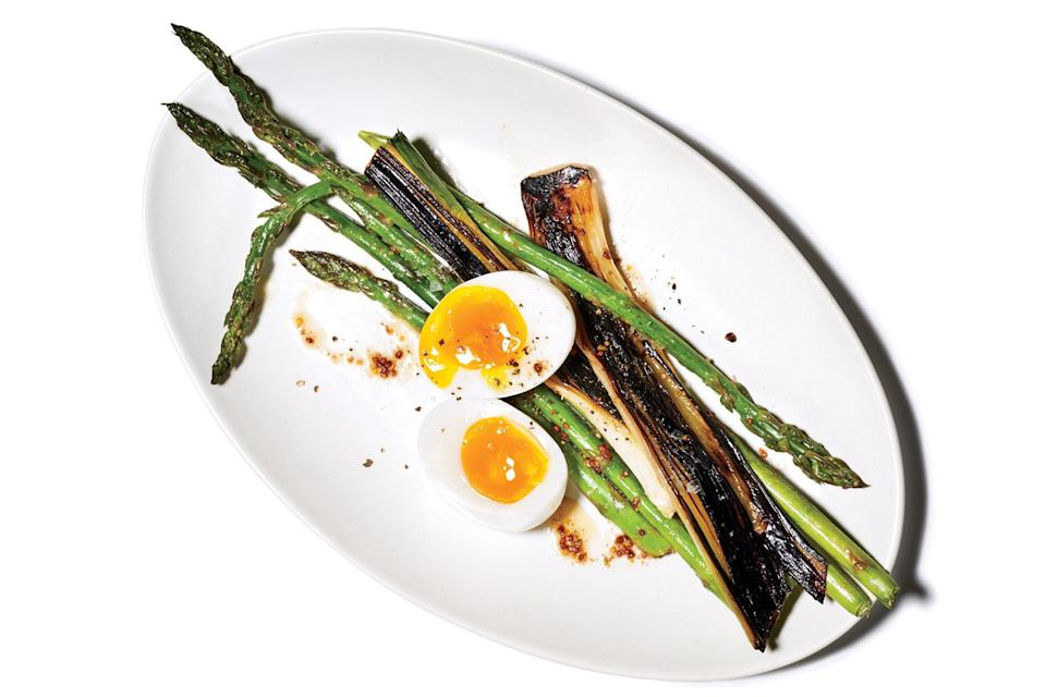 """Blister leeks to transform the crunchy, spicy veggie into something soft and smoky. <a href=""""https://www.epicurious.com/recipes/food/views/blackened-leeks-with-asparagus-and-boiled-eggs?mbid=synd_yahoo_rss"""" rel=""""nofollow noopener"""" target=""""_blank"""" data-ylk=""""slk:See recipe."""" class=""""link rapid-noclick-resp"""">See recipe.</a>"""