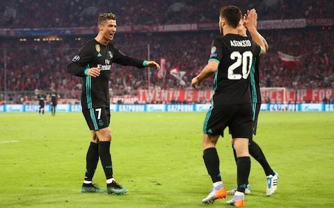 It looks like Cristiano is heading for a meeting with Mo as Real Madrid took a lead, and two away goals, with them to the second-leg of their Champions League semi-final against Bayern Munich in Spain next week. Given the wildly fluctuating score-lines that this competition can provoke and given Juventus went so close in scoring three times at the Bernabeu in the last round then Bayern cannot be ruled out, and felt they should have won and not lost here, just as Roma will hope they can overturn Liverpool's 5-2 Mohamed Salah-inspired advantage. But it does seem to be set for Real Madrid versus Liverpool, Cristiano Ronaldo, who was quiet on this occasion, failing to score for the first time in 12 games, against Salah whose exploits were played on the big screen prior to kick-off and whose name was on everyone's lips. Liverpool should fancy their chances against this Real defence and goalkeeper Keylor Navas but they will also know the threat posed by the most successful team in European history and their talisman in what would be a re-run of the 1981 European Cup Final. A Kenny Dalglish-led Liverpool won then. Now they have his heir, Salah. But this Real always seem to find a way and that is their greatest strength. They inflicted Bayern's first home defeat of the season and how bitter it was for the Germans that they should succumb to these opponents. Again. This is the most recurring match-up in Europe, a 25th meeting of these super-clubs, but Real have won the last six. Including winning here last season, by the same score-line, in the quarter-finals. Bayern were deeply unfortunate in the second leg and they will have believed that the Gods conspired against them once more. Not only did they lose but they lost Arjen Robben, Jerome Boateng and Javi Martinez to injury. Real Madrid players celebrate Asensio's goal Credit: REUTERS Their evening was summed up when Thomas Muller and Robert Lewandowski got in each other's way as one of them had to score with the Bayern cap