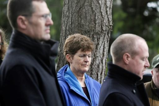 Pat Herrick (C), whose mom Elaine Herrick, 89, a resident of Life Care Center who died, listens during a press conference by family members of residents of the nursing home, where some have died from COVID-19, in Kirkland, Washington on March 5, 2020