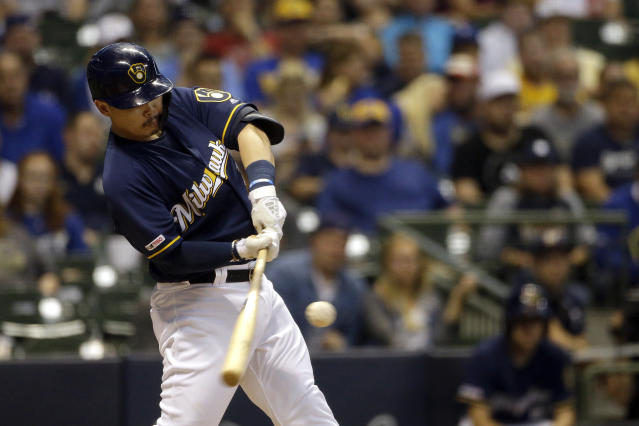 Milwaukee Brewers' Keston Hiura hits a two-run home run during the first inning of a baseball game against the Pittsburgh Pirates, Saturday, Sept. 21, 2019, in Milwaukee. (AP Photo/Aaron Gash)