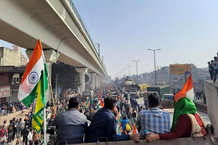 Farmers march through Delhi as part of the tractor rally on January 26, 2021.