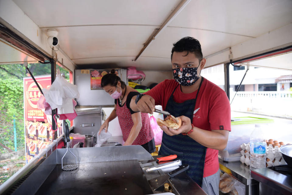 Tan Boon prepares one of the orders for a customer at the food truck.