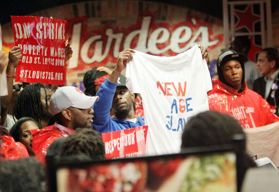 <p> FILE - In this Tuesday, July 30, 2013 file photo, demonstrators fill the Hardees on Chestnut in Downtown St. Louis. On Thursday, Aug. 29, 2013, organizers say thousands of workers are set to stage walkouts in at least 50 cities around the country, part of a push to intensify the spotlight on the wages paid by chains such as McDonald's, Taco Bell and Wendy's. (AP Photo/Belleville News-Democrat, Derik Holtmann)</p>