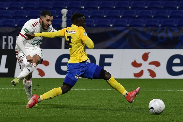 Rayan Cherki (L) scored two goals as Lyon eased into the last 16 of the French Cup