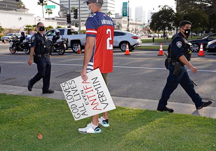 """A man with an anti-antifa sign at a Trump rally in Beverly Hills, Calif., Oct. 10, 2020, <span class=""""copyright"""">Jamie Lee Curtis Taete</span>"""