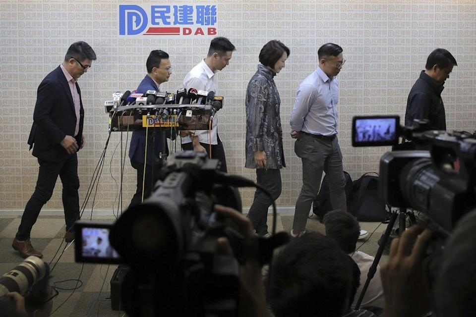 Starry Lee (fourth from left), chairperson of the Democratic Alliance for Betterment of Hong Kong, and her candidates leave after a press conference in Hong Kong on Monday. Photo: AP