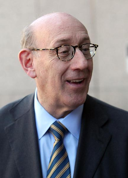 One Fund Boston administrator Kenneth R. Feinberg speaks with reporters after leading a town hall meeting held to discuss how victims of the Boston Marathon bombing will be compensated, Tuesday, May 7, 2013 at the Boston Public Library in Copley Square. (AP Photo/Boston Herald, Angela Rowlings, Pool)
