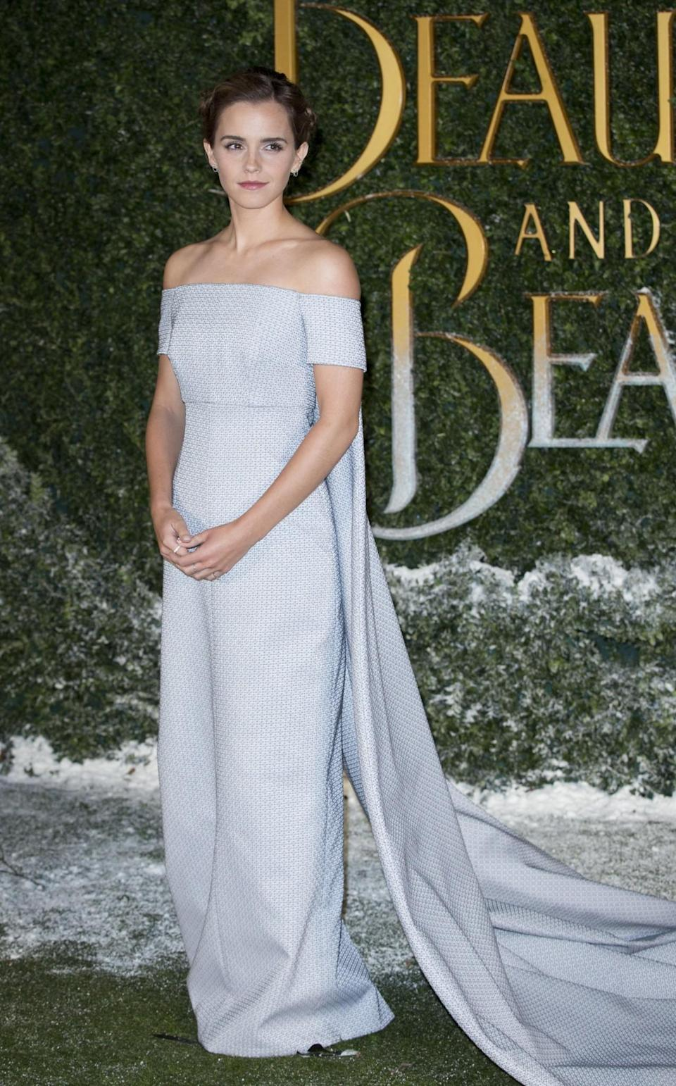 <p>For the London premiere of 'Beauty and the Beast', the British actress stepped out in a Cinderella-esque blue gown. The off-the-shoulder design by Emilia Wickstead featured a huge train that required its own handler on the grassy carpet. <em>[Photo: PA]</em> </p>