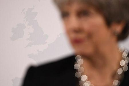 Britain's Prime Minister Theresa May stands in front of an image of the UK as she delivers a speech about her vision for Brexit, at Mansion House in London, Britain, March 2, 2018. REUTERS/Leon Neal/Pool/Files