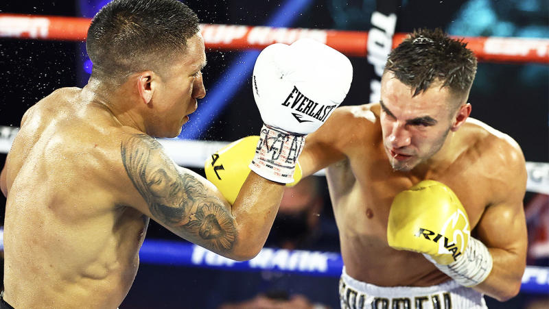 Aussie Andrew Moloney punches Joshua Franco during their WBA Super-Flyweight World Title fight. (Photo by Mikey Williams/Top Rank via Getty Images)