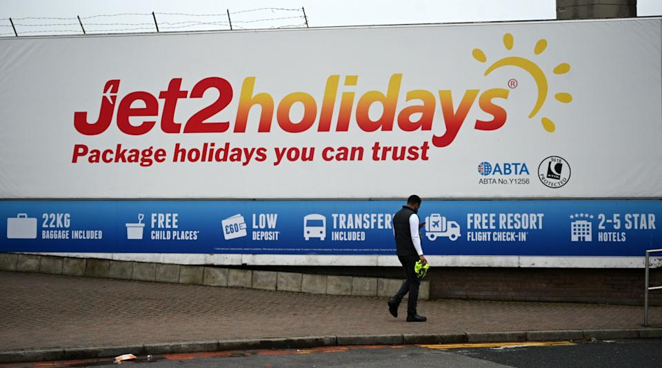 An advert for the Jet2 holidays is pictured near Leeds Bradford airport on August 16, 2020. - The British Airline Pilots Association (Balpa) union said on saturday that Leeds-based carrier was to press ahead with its plan to cut 102 pilot jobs after flights were grounded due to the novel coronavirus pandemic. (Photo by Oli SCARFF / AFP) (Photo by OLI SCARFF/AFP via Getty Images)