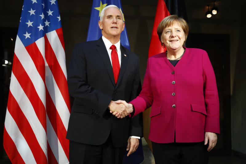 The Latest: Merkel defends Iran deal; Pence blasts Europe