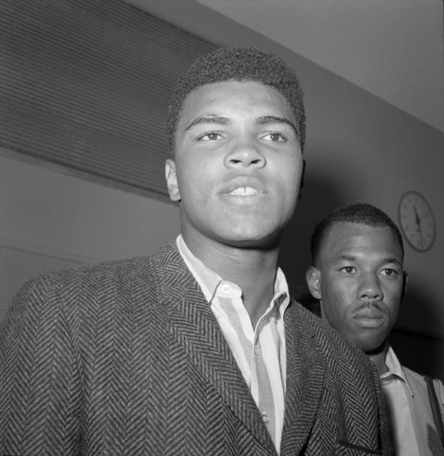 Muhammad Ali, left, and his friend, photographer Howard Bingham in 1964. (Photo: Getty Images).