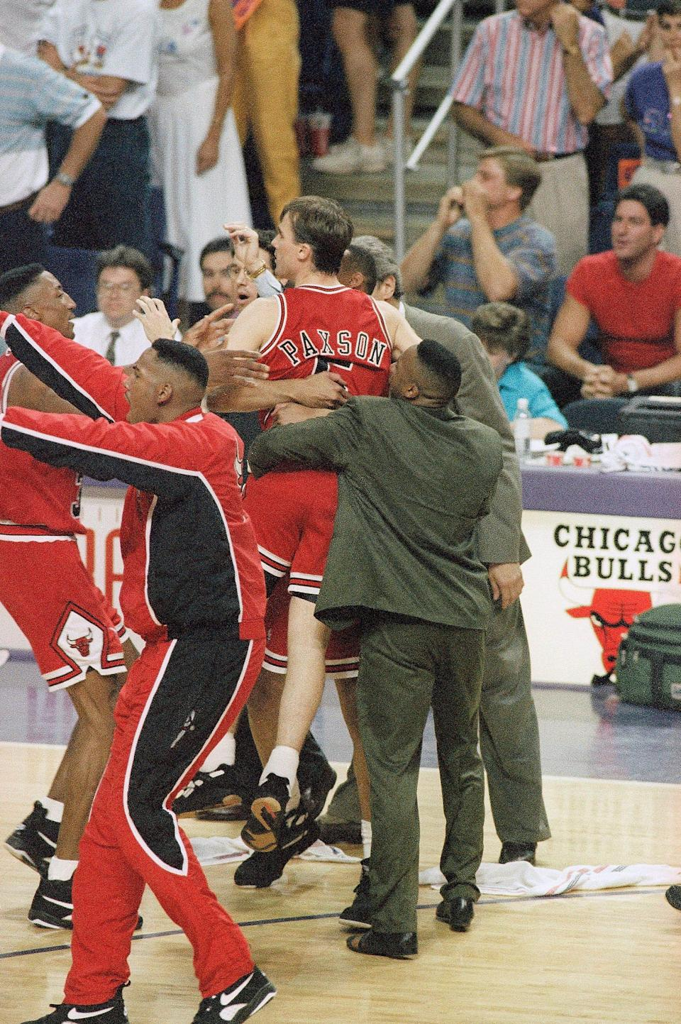 Chicago's John Paxson gets mobbed after his 3-point shot with 3.9 seconds left in the game over the Suns in Game 6 of the 1993 NBA Finals.