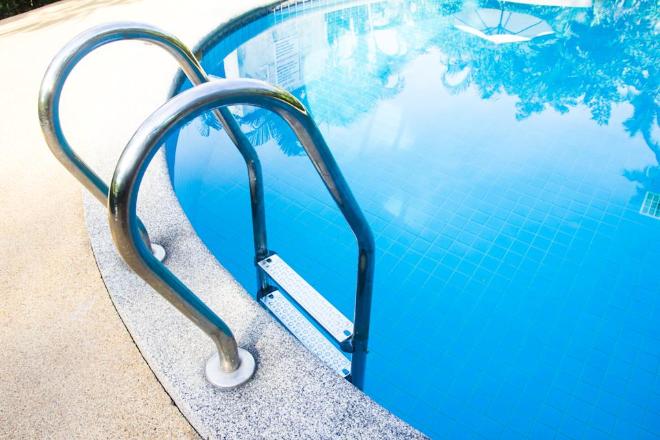 swimming pool with steel ladder.