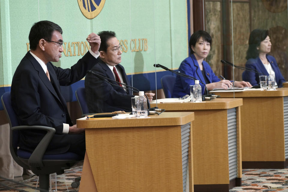 Candidates for the presidential election of the ruling Liberal Democratic Party attend a debate session hosted by the Japan National Press Club Saturday, Sept. 18, 2021 in Tokyo. The contenders are, from left, Taro Kono, the cabinet minister in charge of vaccinations, Fumio Kishida, former foreign minister, Sanae Takaichi, former internal affairs minister, and Seiko Noda, former internal affairs minister. (AP Photo/Eugene Hoshiko, Pool)