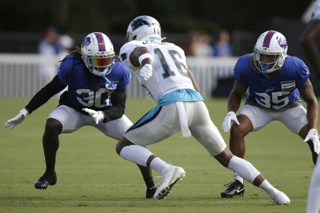 Carolina Panthers' Andre Levrone (16) runs a play against Buffalo Bills Lafayette Pitts (30) and Abraham Wallace (35) during an NFL football training camp in Spartanburg, S.C., Wednesday, Aug. 14, 2019. (AP Photo/Gerry Broome)