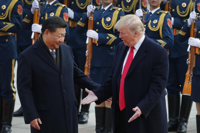 U.S. President Donald Trump, right, and Chinese President Xi Jinping gesture to each others during a welcome ceremony at the Great Hall of the People in Beijing. Trump has touted his friendship with President Xi as a benefit when negotiating new trade agreements for the U.S. (AP Photo/Andy Wong)