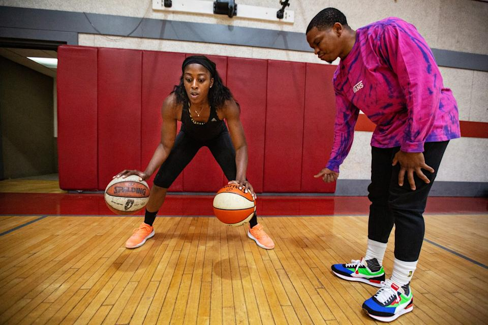 Chiney Ogwumike works with Sparks player development coach Dash Lovell during a training session March 9, 2020.