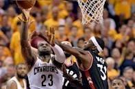 May 25, 2016; Cleveland, OH, USA; Cleveland Cavaliers forward LeBron James (23) drives to the basket as Toronto Raptors forward Terrence Ross (31) defends during the third quarter in game five of the Eastern conference finals of the NBA Playoffs at Quicken Loans Arena. The Cavs won 116-78. Mandatory Credit: Ken Blaze-USA TODAY Sports