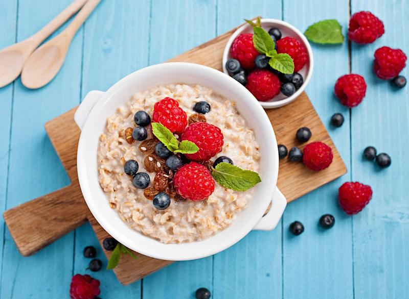 oatmeal with berries in a white bowl